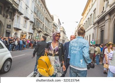 MILAN, ITALY - SEPTEMBER 27: People gather outside Trussardi fashion show building for Milan Women's Fashion Week on SEPTEMBER 27, 2015  in Milan.