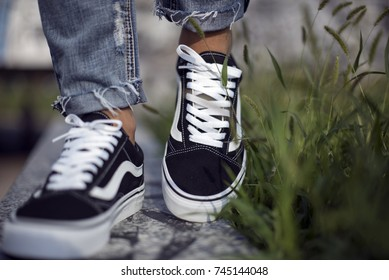 Milan, Italy - September 28, 2017: Vans Old Skool shoes in the street - illustrative editorial
