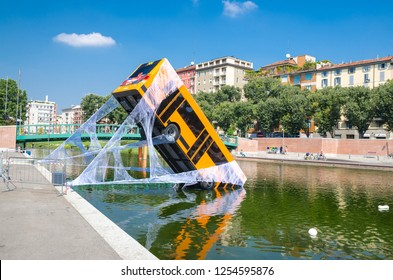Milan, Italy, September 9, 2018: bus partially immersed in lake, fell into river and kept on web, spiderman movie advertising