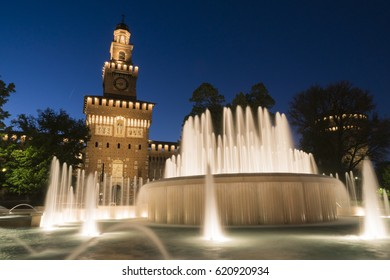 Milan, Italy. Sforzesco castle and Piazza Castello fountain. Night view
