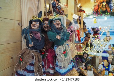 Milan, Italy-2018.12-Dolls of Befana, which is an old woman who delivers gifts to children throughout Italy on Epiphany Eve (the night of January 5), in the Christmas market of Milan.