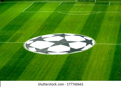 MILAN, ITALY-APRIL 10, 2007: Top view of the UEFA Champions League logo laying on the pitch of the San Siro soccer stadium.