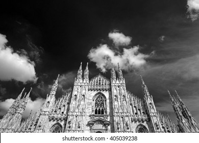 MILAN, ITALY-APRIL 12, 2016: black and white of the gothic Duomo cathedral facade in Milan.