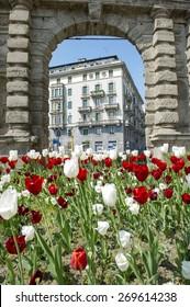 MILAN, ITALY-APRIL 13, 2015: flowers garden decorates the monumental arch of Porta Romana, in Milan.