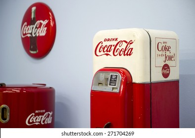 MILAN, ITALY-APRIL 17, 2015: vintage Coca Cola refrigerators and signs displayed during the exhibition Arts and Foods, at La Triennale museum, in Milan.