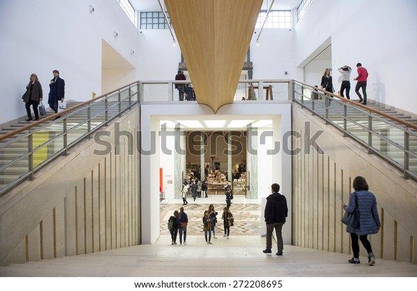 MILAN, ITALY-APRIL 17, 2015: visitors inside the architecture, design and arts museum La Triennale, in Milan.