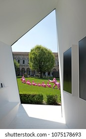 MILAN, ITALY-APRIL, 17, 2018: design elements displayed on the historical courtyard of the Statale University,at Fuori Salone, during the International Design week, of the Salone del Mobile, in Milan.