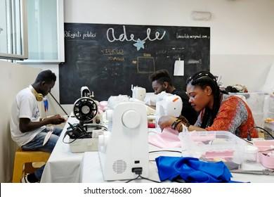 MILAN, ITALY-APRIL 18, 2018: political refugees working on a tailoring of the no-profit association Linea Adele, in Milan.