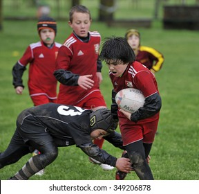 MILAN, ITALY-APRIL 21, 2014: children playing rugby in the park during a rugby school, in Milan.