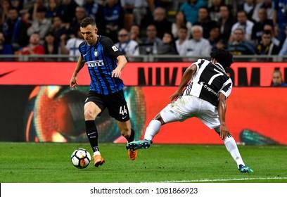 MILAN, ITALY-APRIL 28, 2018: Ivan Perisic (CRO) and Juan Vuadrado (COL) in action during the italian serie A match Inter Milan vs FC Juventus, at the san siro soccer stadium, in Milan.