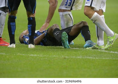 MILAN, ITALY-AUGUST 23, 2015: FC Internazionale soccer player laying on the grass after injuring during the italian serie A match FC Internazionale vs Atalanta at the San Siro stadium, in Milan.