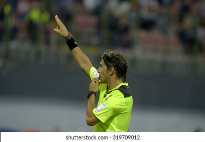 MILAN, ITALY-AUGUST 23, 2015: soccer referee whistles during a soccer match at the San Siro stadium, in Milan.