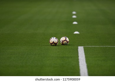 MILAN, ITALY-AUGUST 26, 2018: soccer balls and training equipment on the green soccer pitch of the san siro stadium, in Milan.