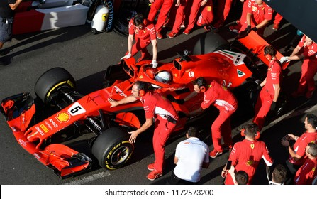MILAN, ITALY-AUGUST 29, 2018: Ferrari's Formula 1 driver, Sebastain Vettel, assisted by the Ferrari pit stop crew, during an exhibition at the F1 Milan Festival, on the Darsena roads, in Milan.