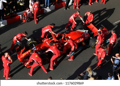 MILAN, ITALY-AUGUST 29, 2018: top view of the Ferrari Formula 1's pit stop crew, during an exhibition on a city circuit along the Darsena district, in Milan.