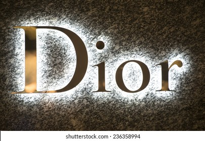 MILAN, ITALY-DECEMBER 02, 2014: Dior brand name outside a boutique store in the downtown fashion district, in Milan.