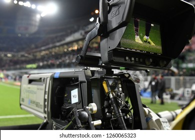 MILAN, ITALY-DECEMBER 09, 2018: tv camera man shooting live a professional soccer match, at the san siro footballa stadium, in Milan.