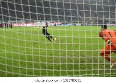 MILAN, ITALY-FEBRUARY 01, 2019: soccer penalty kick seen under the net goalpost, at the san siro soccer stadium at night, in Milan