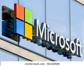 MILAN, ITALY-FEBRUARY 14, 2017: Microsoft logo company on the window facade of the new Microsoft headquarter, in Milan.