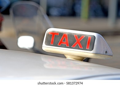 MILAN, ITALY-FEBRUARY 14, 2017: white taxi cab on the traffic, in Milan.