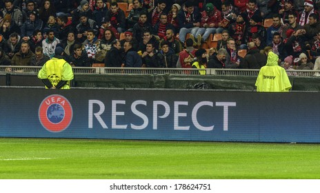 MILAN, ITALY-FEBRUARY 19, 2014: UEFA Champions League fair play's slogan it's seen during the soccer match AC Milan vs Athletic Madrid, at  the San Siro stadium.