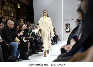 MILAN, ITALY-FEBRUARY 21, 2019: female models catwalk, during the Giada's fall/winter fashion show, inside the Braidense library of the Brera's Pinacoteca, in Milan.