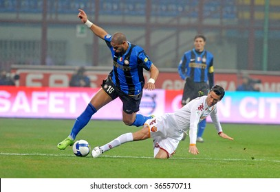 MILAN, ITALY-FEBRUARY 29, 2008: soccer players Adriano and Christian Panucci in action during the italian serie A soccer match FC Internazioanle vs AS Roma, at the san siro stadium,  in Milan