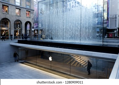 MILAN. ITALY-JANUARY 10, 2019: Apple store outdoor entrance gate, with the fountain cube glass, in Liberty square, in Milan.
