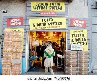MILAN, ITALY-JANUARY 17, 2018: shopping window sales are displayed on clothing and shoes store, in Milan.