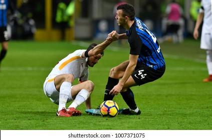 MILAN, ITALY-JANUARY 21, 2018: Alessandro Florenzi, AS Rome player, and Ivan Perisic, FC Internazionale player,  fair play at san siro soccer stadium, in Milan.