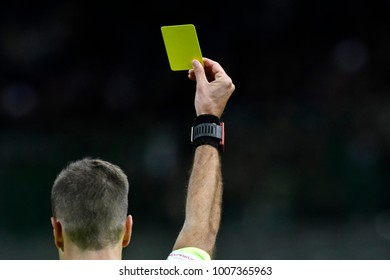 MILAN, ITALY-JANUARY 21, 2018: soccer referee shows yellow card, in Milan.