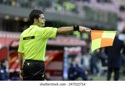 MILAN, ITALY-JANUARY 25, 2015: soccer linesman referee wave the flag to point an offside, at the san siro stadium for the serie A match FC Internazionale vs Torino, in Milan.