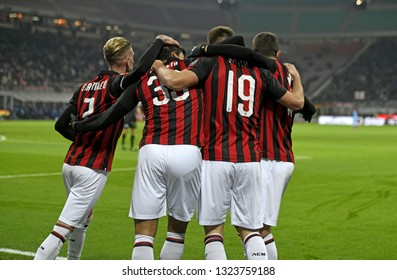 MILAN, ITALY-JANUARY 29, 2019: AC Milan soccer players embrace to celbrate the win, at the san siro soccer stadium at night, in Milan