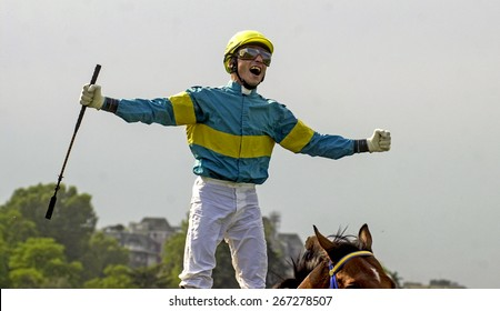MILAN, ITALY-JUNE 16, 2002: jockey celebrates the win of a race horses at the racecourse, in Milan.