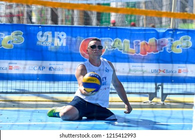 MILAN, ITALY-JUNE 30, 2018: amputee man volleyball player, during a sports summer camp, in Milan.