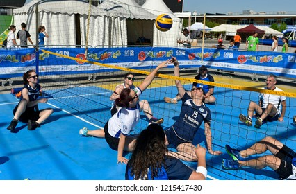 MILAN, ITALY-JUNE 30, 2018:  outdoor disability volleyball match, during a sports summer camp, in Milan.