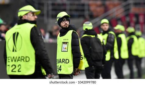 MILAN, ITALY-MARCH 08, 2018: security steward staff at the San Siro soccer stadium at night, during the UEFA League match AC Milan vs Arsenal, in Milan.
