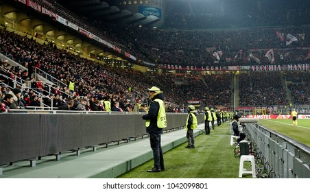 MILAN, ITALY-MARCH 08, 2018: security steward staff at the San Siro soccer stadium at night, during the UEFA League match AC Milan vs Arsenal, in Milan.