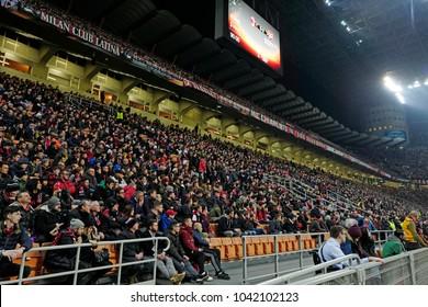 MILAN, ITALY-MARCH 08, 2018: soccer stadium fans watching the match at the San Siro soccer stadium at night, during the UEFA League match AC Milan vs Arsenal, in Milan.