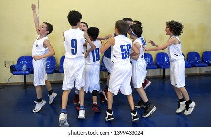 MILAN, ITALY-MARCH, 16, 2019: kids basketball team, celebrate the win of a basketball kids final competition, in Milan.