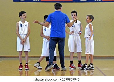 MILAN, ITALY-MARCH, 16, 2019: kids basketball team listen to their coach, during time-out, of a basketball kids final competition, in Milan.