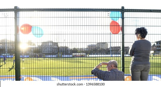 MILAN, ITALY-MARCH 16, 2019: parents following and supporting, a kids soccer match on tribune, in Milan.