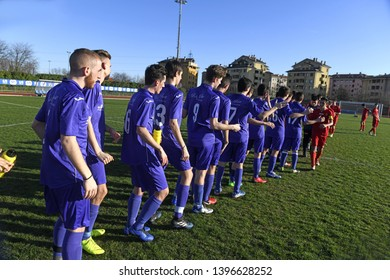 MILAN, ITALY-MARCH 16, 2019: youth soccer teams, fair play at the end of the match, in Milan.