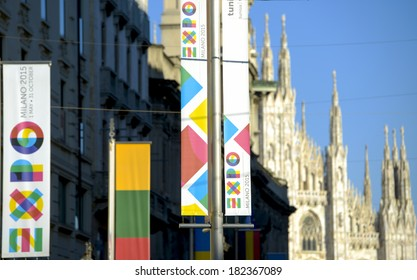 MILAN, ITALY-MARCH 17, 2014: International Exhibition EXPO 2015 banners, exposed in front of the Duomo cathedral, in Milan.