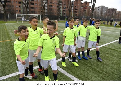 MILAN, ITALY-MARCH 17, 2019: kids soccer teammates embrace each other during penalty kicks, in Milan.