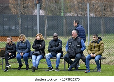MILAN, ITALY-MARCH 17, 2019: parents watching and supporting during a kids soccer match, in Milan.