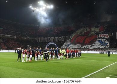MILAN, ITALY-MARCH 17, 2019: soccer teams enter at the san siro stadium during the italian Serie A soccer match AC Milan vs Inter Milan, in Milan.