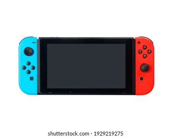 Milan, Italy-March 2021: View of Nintendo Switch Game Console front view blank screen isolated on white. Ideal for having fun with friends and family.