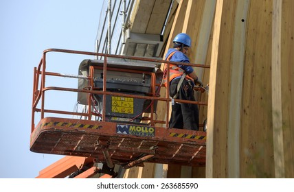 MILAN, ITALY-MARCH 23, 2015: crane worker on Porta Nuova building construction site, in Milan.