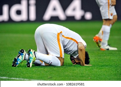 MILAN, ITALY-MAY 07, 2017: AS Roma's egyptian soccer player, Momamed Salah, prays as a muslim does, after score during the italian league match AC Milan vs AS Roma, at the san siro stadium, in Milan.